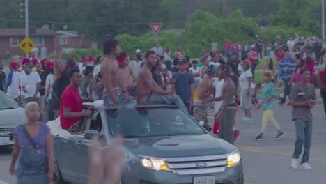 Protesters-march-drive-by-and-chant-in-the-streets-of-Ferguson-Missouri