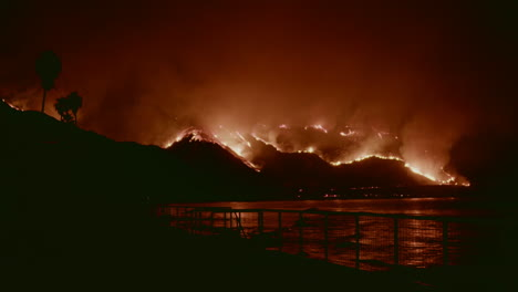 Spectacular-view-of-California-hillsides-on-fire-beside-the-ocean-during-the-Thomas-Fire