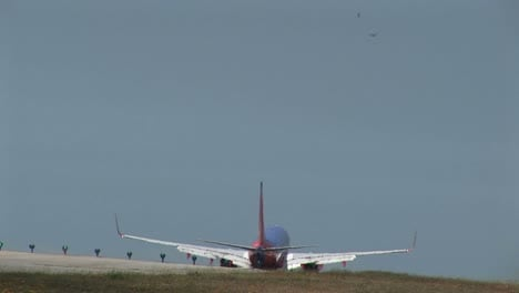A-Southwest-jet-airplane-lands-on-an-airport-runway-1
