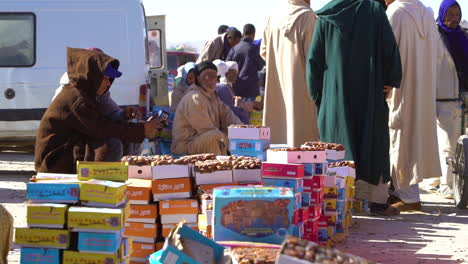 Moroccan-men-sit-beside-the-road-selling-goods