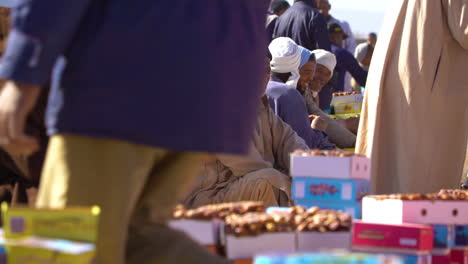 Moroccan-men-sit-beside-the-road-selling-goods-1