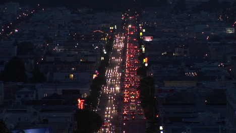 Birds-eyeshot-of-traffic-moving-in-a-large-city-at-night