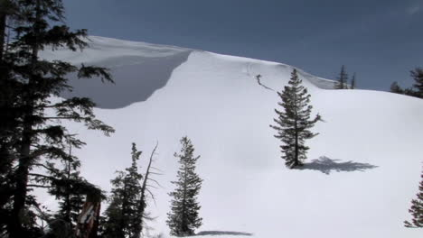Long-shot-of-a-snowboarder-on-a-pristine-mountain-slope
