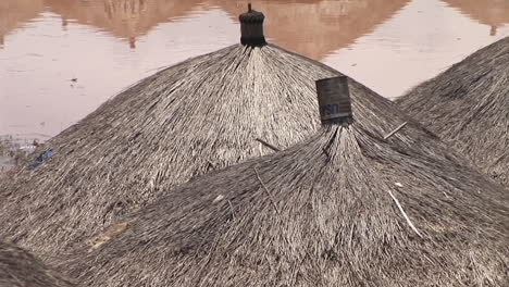 Panup-shot-of-a-Ugandan-village-in-Africa-with-thatched-roofs