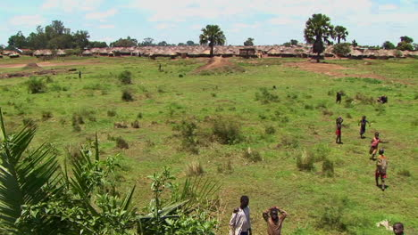 Panshot-of-open-fields-and-a-refugee-camp-in-Northern-Uganda-Africa