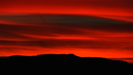 A-brilliant-red-sky-glows-above-a-rolling-mountain