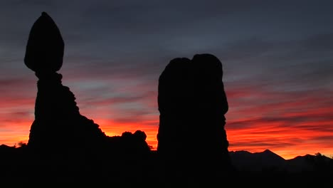 A-red-and-blue-sky-silhouettes-rock-formations-in-Arches-National-Park-Utah