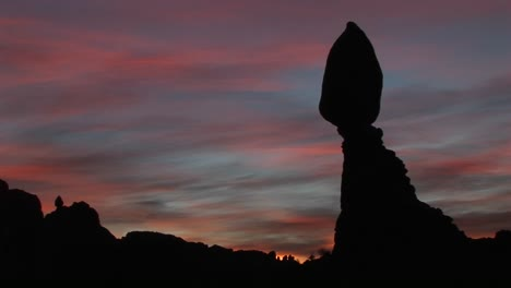Balanced-Rock-is-silhouetted-against-a-brilliant-sky-in-Arches-National-Park-Utah