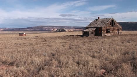 Long-shot-of-an-abandoned-homestead-on-a-lonely-prairie