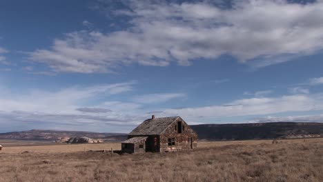 Long-shot-of-an-old-abandoned-homestead-in-the-middle-of-a-lonely-prairie