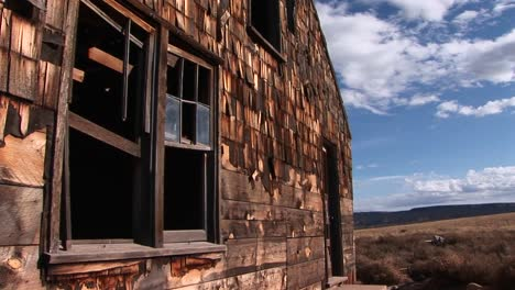 Medium-shot-of-an-old-abandoned-homestead-a-lonely-prairie-1