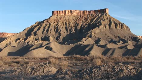 Long-shot-of-a-magnificent-desert-formation-that-looks-like-a-fortress