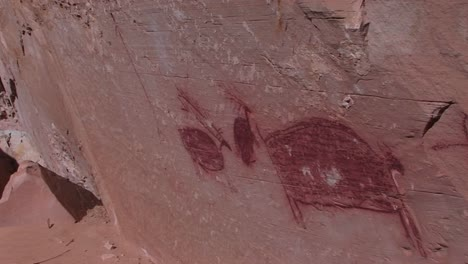 Panright-slowly-across-the-face-of-a-cliff-to-an-American-Indian-pictograph