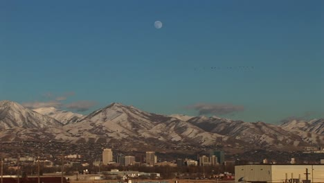 Long-shot-of-Salt-Lake-City-Utah-with-the-moon-rising-behind