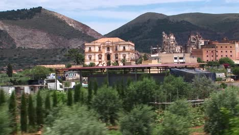POV-of-a-city-working-on-buildings-with-old-architecture-in-Palermo-Italy