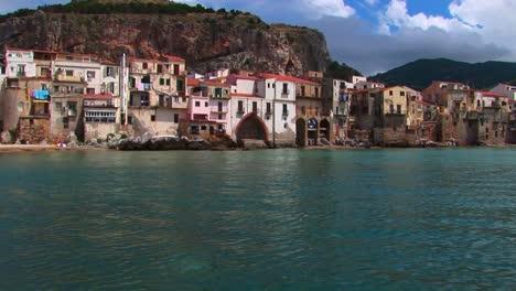 Ocean-water-near-beach-houses-in-Cefalu-Italy-1