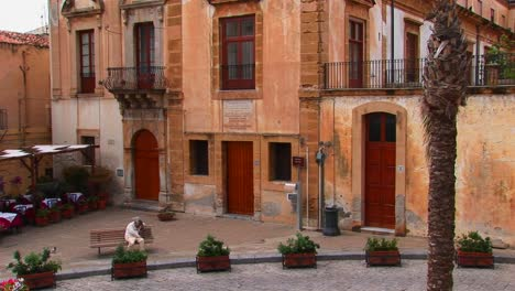 Street-lamps-and-brick-buildings-are-within-close-proximity-of-one-another-in-Cefalu-Italy-1