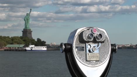 A-tourist-telescope-overlooks-the-Statue-of-Liberty
