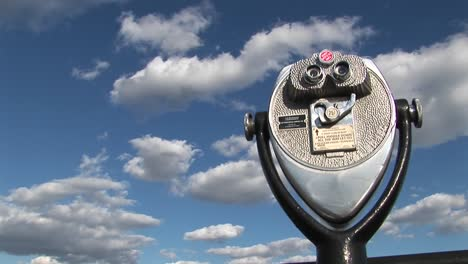 A-time-lapse-of-clouds-moving-over-a-tourist-telescope