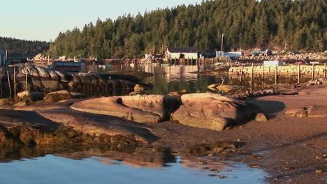 A-small-lobster-village-building-in-Stonington-Maine-is-on-a-rock-island-and-pier-1