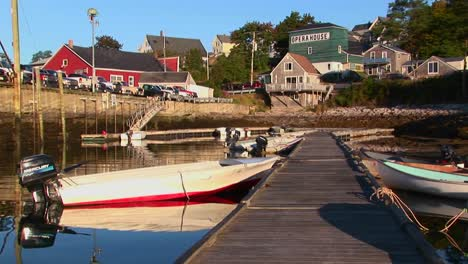 Boats-are-tied-to-a-dock-leading-to-a-lobster-village-in-Stonington-Maine