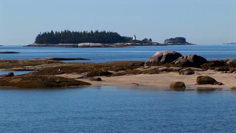 Water-moves-between-small-islands-offshore-a-lobster-village-in-Stonington-Maine-2