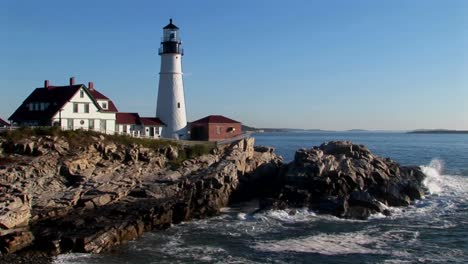 The-Portland-Head-Lighthouse-oversees-the-ocean-from-rocks-in-Maine-New-England-1