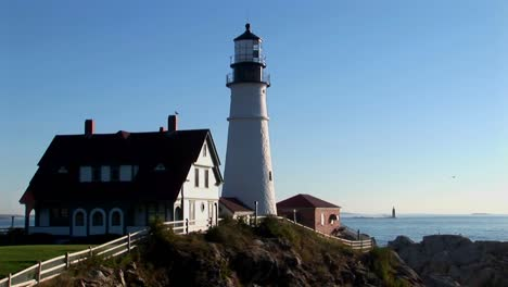 The-Portland-Head-Lighthouse-oversees-the-ocean-from-rocks-in-Maine-New-England-4