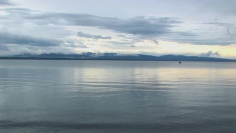 Smooth-water-ripples-under-a-grey-sky-at-Lake-Champlain-in-Vermont
