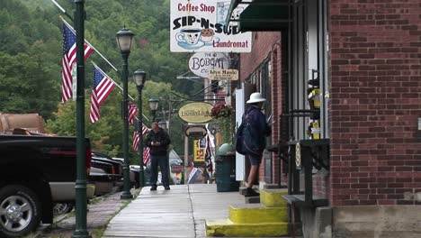 People-walk-into-small-downtown-stores-in-Vermont