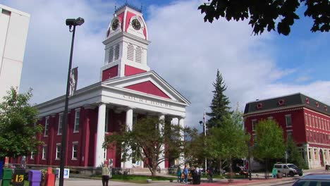 Pedestrians-and-vehicles-travel-pass-a-historic-court-house-in-Montpelier-Vermont