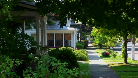 A-tree-covered-pathway-near-houses-on-a-street-in-small-town-America