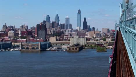 A-rapid-transit-train-drives-across-Ben-Franklin-Bridge-away-from-Philadelphia-Pennsylvania-