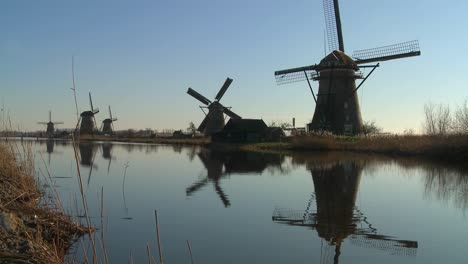 Windmills-line-a-canal-in-the-Netherlands