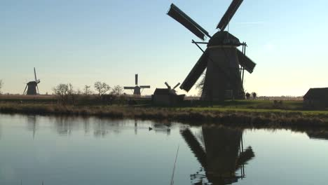 A-tilt-up-to-windmills-along-a-canal-in-Holland