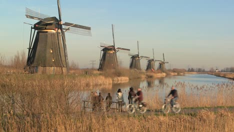Many-windmills-line-up-in-a-perfect-row-along-a-canal-in-Holland