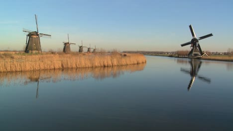 Windmills-line-a-canal-in-Holland