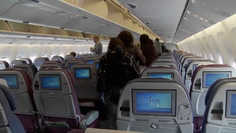 The-interior-of-a-modern-airplane-with-passengers-boarding