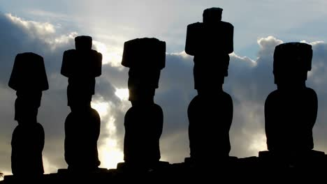 Clouds-move-mysteriously-behind-Easter-Island-statues