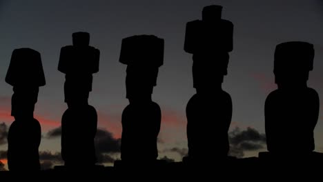 The-sun-sets-behind-Easter-Island-statues