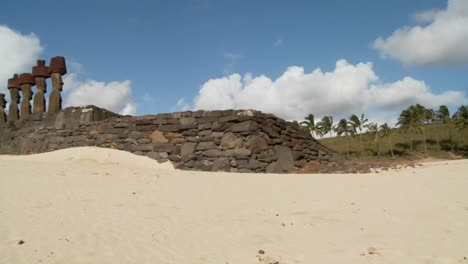 A-pan-across-to-Easter-Island-statues-on-a-beach-in-the-distance