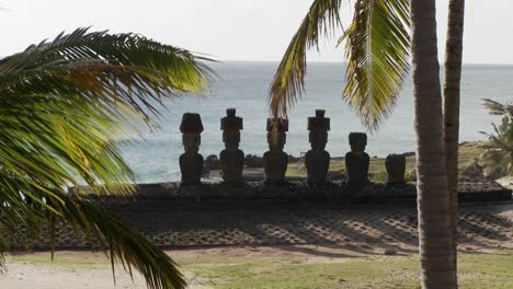 Easter-Island-statues-with-the-ocean-in-the-background-and-palms-waving