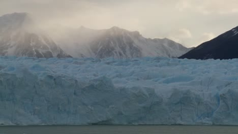 A-shot-looking-across-a-glacier-to-mountains-in-background