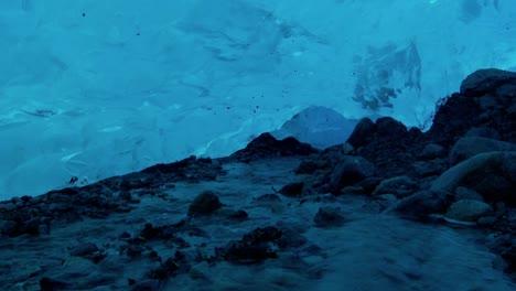 An-underground-river-flows-beneath-an-ice-cave