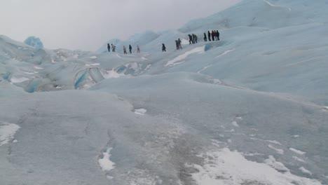 A-group-of-explorers-move-across-a-glacier