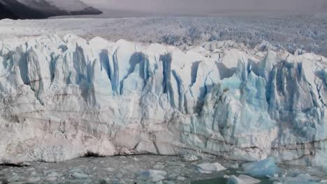 Pan-across-a-vast-glacier-where-it-meets-the-sea