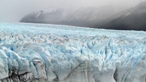 Pan-across-a-vast-arctic-glacier-with-ice-stretching-into-the-distance