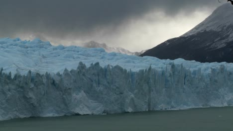 Time-lapse-of-clouds-moving-across-a-glacier
