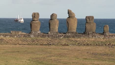 Broken-statues-on-Easter-Island-with-a-boat