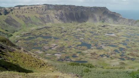 Pan-across-an-immense-volcanic-cone-crater-lake-on-Easter-Island